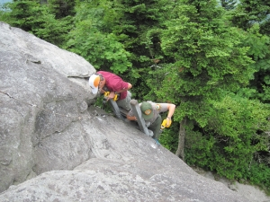 Staff replacing rock anchors on McCrae's Peak, Grandfather Mountain State Park. From the collection of North Carolina State Parks.