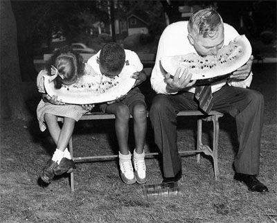 Governor Gregg Cherry eating watermelon with children, 1945-1949.  Image from the collections of the North Carolina Museum of History, used courtesy of the North Carolina Department of Cultural Resources.