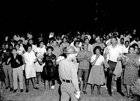 This image is of a group of African American protesters chanting and clapping on the lawn of the Executive Mansion in Raleigh, North Carolina.