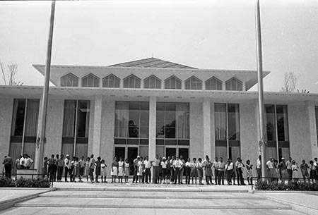 This is a 1963 photograph of African American protestors gathered outside the Legislative Building in Raleigh. This image is copyrighted and belongs to the Raleigh News and Observer.