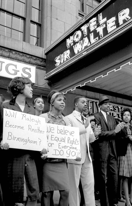 This is an image of African Americans picketing in Raleigh, North Carolina, outside of the Sir Walter Hotel in 1963.