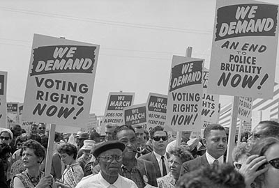 This photograph is of black and white marchers on August 28, 1963, during the historic March on Washington. Image from Library of Congress.