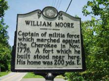 This is an image of a North Carolina Highway Historical Marker that is of William Moore and is located at SR 3412 (Sand Hill Road) east of Enka in Buncombe County. The marker text reads: Captain of militia force which marched against the Cherokee in November, 1776. A fort which he built stood near here. His home was 200 yards east.