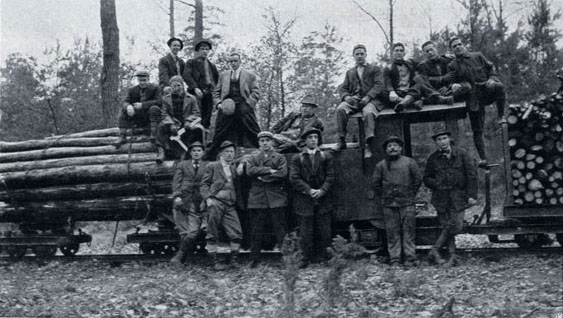Students from the Biltmore Forest School inspecting a portable forest railroad in Darmstadt, Germany circa 1912.