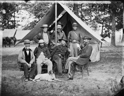 Photograph of General George Stoneman (seated, right) and General Henry M. Naglee (seated, third from left), pose with members of their staffs.
