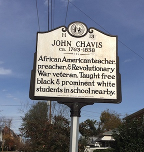 "Photograph of North Carolina Highway historical marker dedicated to John Chavis. Located on Worth Street in Raleigh, NC. Reads: ""African American teacher, preacher, and Revolutionary War veteran. Taught free black & prominent white students in school nearby.""  The marker was erected near the site of his school in Raleigh for the 100th anniversary of his death in 1938. It was the first North Carolina highway historical marker dedicated to African American history."