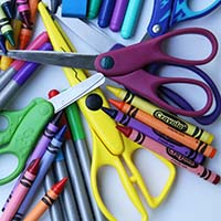 Image of crayons and scissors.