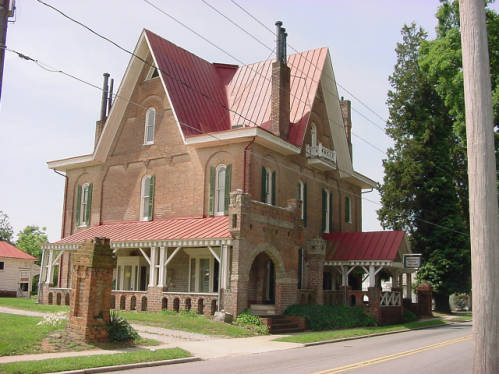 "Photograph of ""Korners Folly"" (pronounced kerners), taken in 2001. Jule Gilmore Korner began construction of the home in 1878 to be a combination of bachelor's quarters, artist studio, office, billiard parlor and ballroom, carriage house and stables, all with a variety of Victorian elements. Image from the NC ECHO project, State Documents Collection, NC Digital Collections."