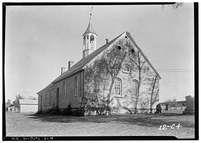 Black and white photograph of Gemeinhaus at Bethabara taken in 1934. Many of the structures of Bethabara -- established in 1753 -- including this Moravian Church, are still standing today in Forsyth County. Image courtesy of Library of Congress