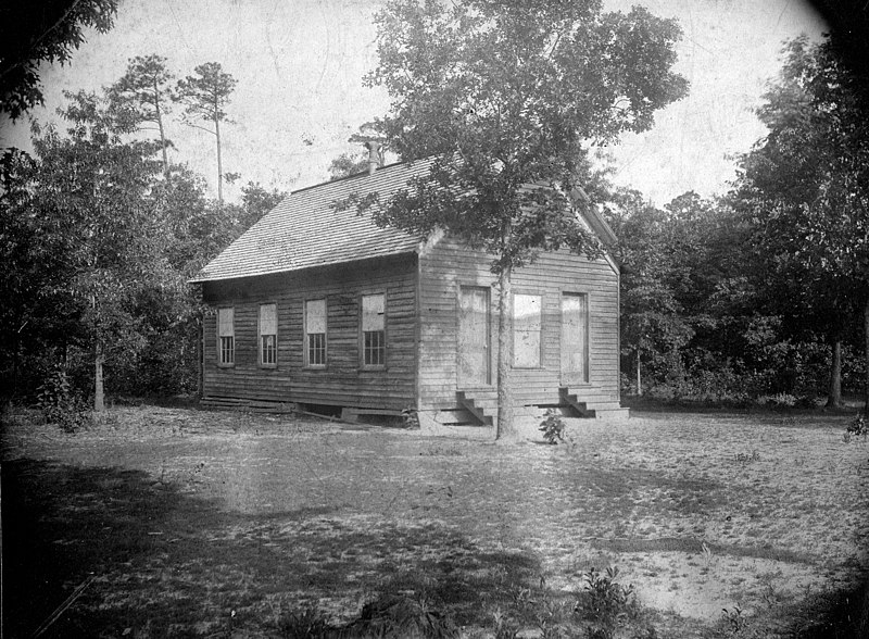 Photograph of an old one-room school in Wayne County, N.C., ca. 1900. The building was typical of the rural schools established in the 19th century. From the collections of the State Archives of N.C.