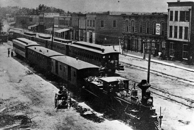 Photograph of Goldsboro, N.C. ca 1870, showing the railroad station and business district on Main Street. Item PhC68_1_34 from Carolina Power and Light (CP&L) Photograph Collection (Ph.C.68), Courtesy of State Archives of North Carolina.