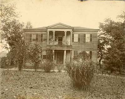 Photograph of Mordecai Plantation house in Raleigh, N.C., ca. 1897, from the collection of the NC Museum of History. The home was originally built in 1785 and then enlarged and restyled in the 1820s in the Greek Revival style popular during the era.