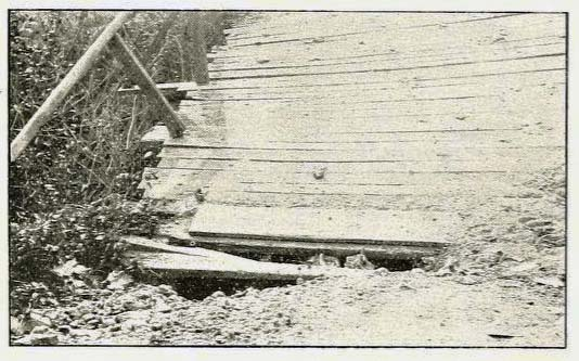 Photograph, ca. 1910, of planks on a bridge in Alabama. Efforts in the 19th to improve road travel for wagons and carriages involved laying planks on roads, similar to planks on bridges. From Henry Varner's Southern Good Roads, February 1911.