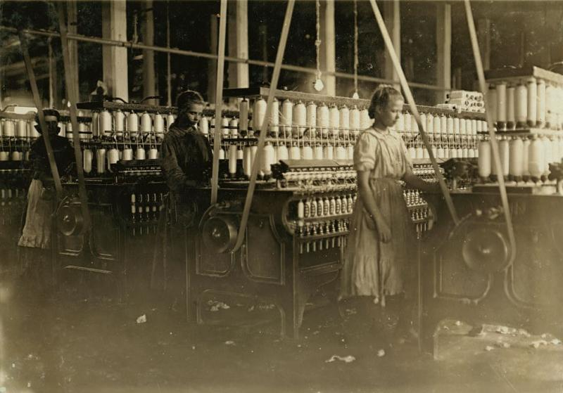 """<img typeof=""""foaf:Image"""" src=""""http://statelibrarync.org/learnnc/sites/default/files/images/01549v.jpg"""" width=""""989"""" height=""""691"""" alt=""""Some of the larger spinners in Catawba Cotton Mills"""" title=""""Some of the larger spinners in Catawba Cotton Mills"""" />"""