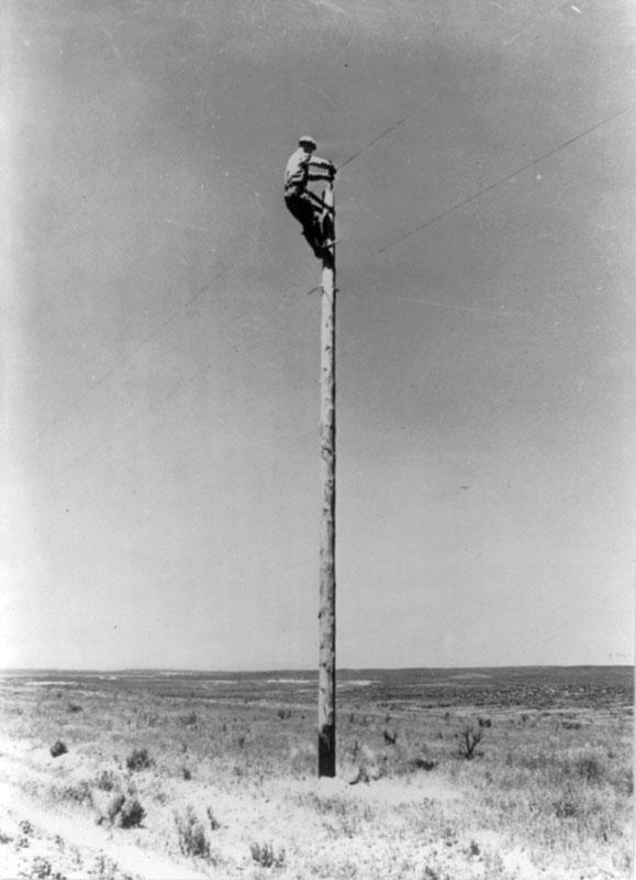 "<img typeof=""foaf:Image"" src=""http://statelibrarync.org/learnnc/sites/default/files/images/3b29801u.jpg"" width=""579"" height=""800"" alt=""Rural electrification: a lineman at work"" title=""Rural electrification: a lineman at work"" />"