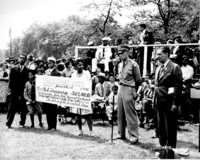 Presenting a check for war bonds