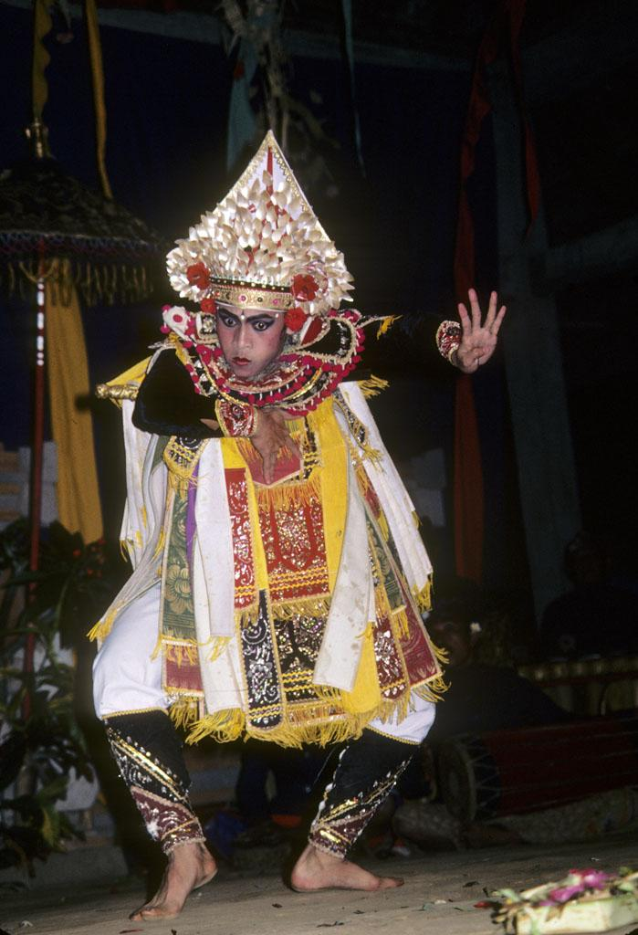 """<img typeof=""""foaf:Image"""" src=""""http://statelibrarync.org/learnnc/sites/default/files/images/bali_249.jpg"""" width=""""699"""" height=""""1024"""" alt=""""Young Balinese male dancer"""" title=""""Young Balinese male dancer"""" />"""