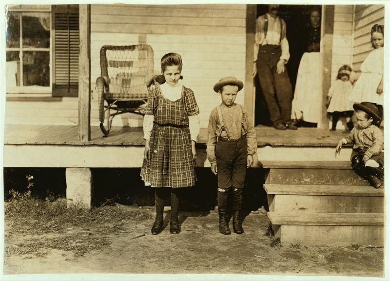 """<img typeof=""""foaf:Image"""" src=""""http://statelibrarync.org/learnnc/sites/default/files/images/carswell_0.jpg"""" width=""""1024"""" height=""""737"""" alt=""""Children at home in a textile mill community"""" title=""""Children at home in a textile mill community"""" />"""