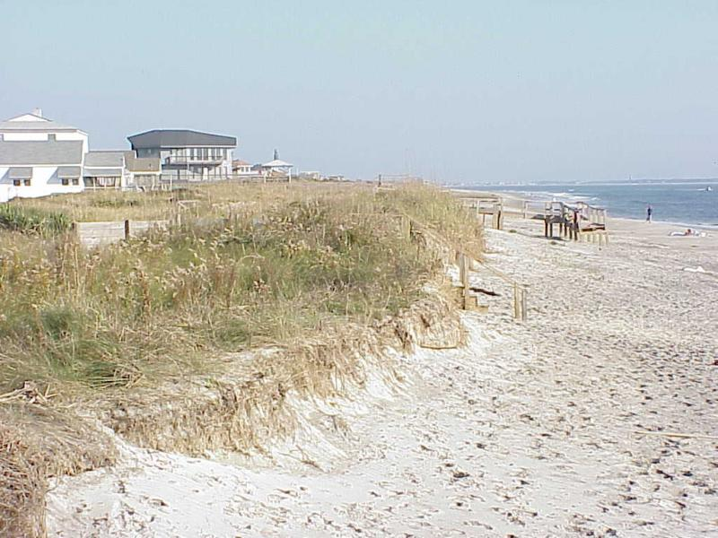 "<img typeof=""foaf:Image"" src=""http://statelibrarync.org/learnnc/sites/default/files/images/hurricane_oak_isld2.jpg"" width=""1024"" height=""768"" alt=""Floyd damage on Oak Island"" title=""Floyd damage on Oak Island"" />"