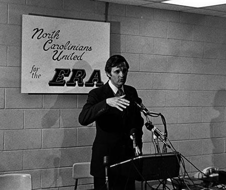 "The photo shows Alda at a podium with a sign behind him reading, ""North Carolinians United for the ERA."""