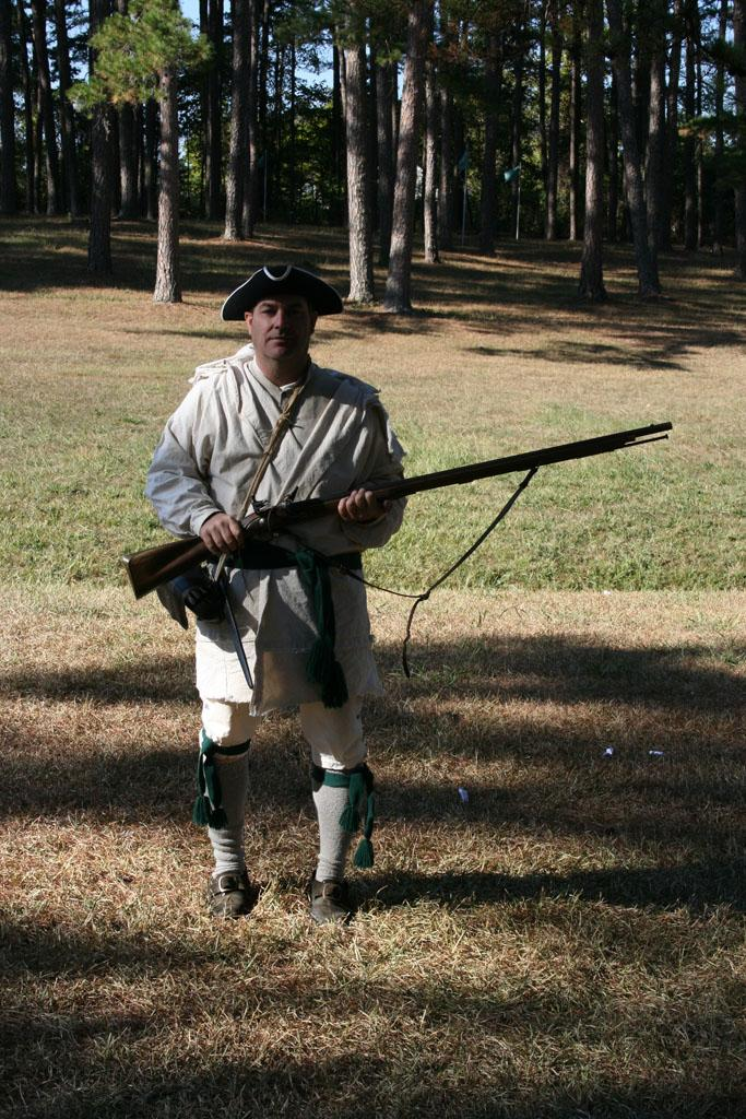 """<img typeof=""""foaf:Image"""" src=""""http://statelibrarync.org/learnnc/sites/default/files/images/img_1628.jpg"""" width=""""683"""" height=""""1024"""" alt=""""Regulator re-enactor with musket"""" title=""""Regulator re-enactor with musket"""" />"""