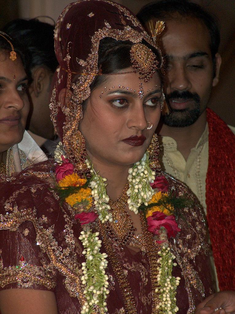 "<img typeof=""foaf:Image"" src=""http://statelibrarync.org/learnnc/sites/default/files/images/india_bride.jpg"" width=""766"" height=""1024"" alt=""Bride in India"" title=""Bride in India"" />"