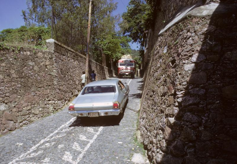 "<img typeof=""foaf:Image"" src=""http://statelibrarync.org/learnnc/sites/default/files/images/mexico_058.jpg"" width=""1024"" height=""709"" alt=""Narrow road in Taxco, Mexico"" title=""Narrow road in Taxco, Mexico"" />"