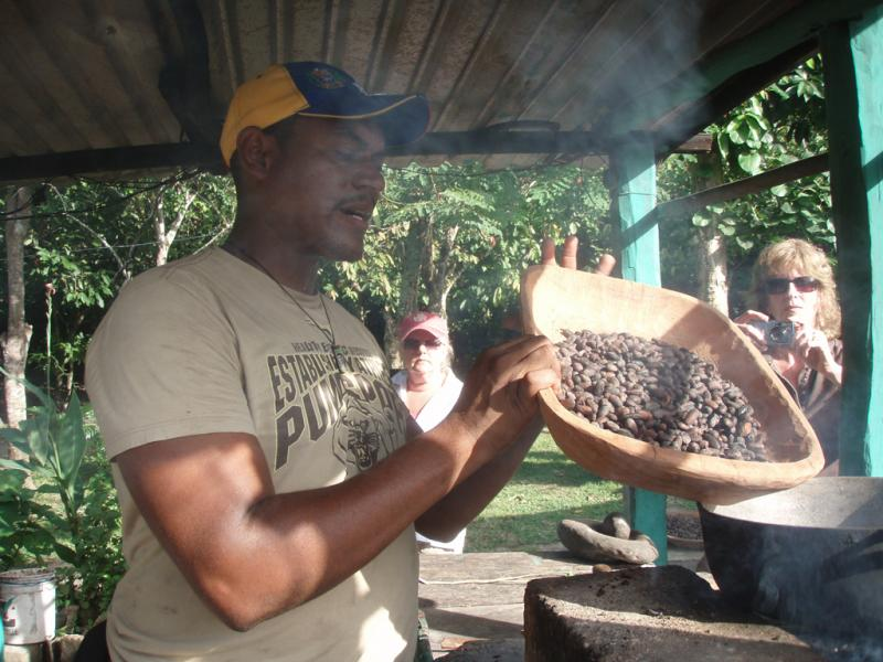 """<img typeof=""""foaf:Image"""" src=""""http://statelibrarync.org/learnnc/sites/default/files/images/p7080620r.jpg"""" width=""""1024"""" height=""""768"""" alt=""""Roasting cacao seeds"""" title=""""Roasting cacao seeds"""" />"""