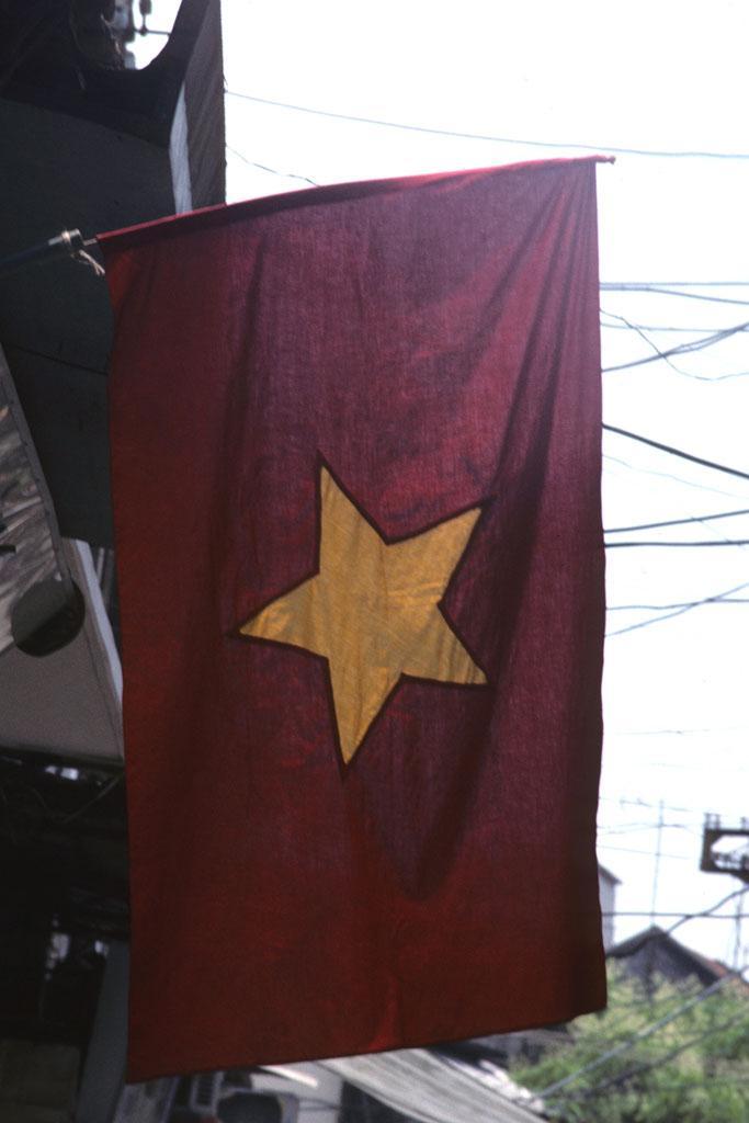 "<img typeof=""foaf:Image"" src=""http://statelibrarync.org/learnnc/sites/default/files/images/vietnam_002.jpg"" width=""683"" height=""1024"" alt=""Flag of Socialist Republic of Vietnam hanging in Hanoi"" title=""Flag of Socialist Republic of Vietnam hanging in Hanoi"" />"
