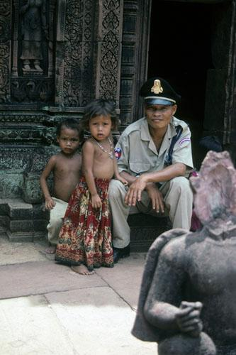 """<img typeof=""""foaf:Image"""" src=""""http://statelibrarync.org/learnnc/sites/default/files/images/vietnam_014.jpg"""" width=""""333"""" height=""""500"""" alt=""""Uniformed guard sits with two small children at Banteay Srei Temple"""" title=""""Uniformed guard sits with two small children at Banteay Srei Temple"""" />"""
