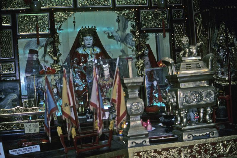 "<img typeof=""foaf:Image"" src=""http://statelibrarync.org/learnnc/sites/default/files/images/vietnam_117.jpg"" width=""1024"" height=""683"" alt=""Figurines and flags on gilded shrine used by Fukian Chinese at Hoi An"" title=""Figurines and flags on gilded shrine used by Fukian Chinese at Hoi An"" />"