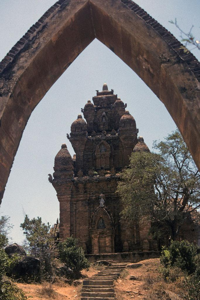 """<img typeof=""""foaf:Image"""" src=""""http://statelibrarync.org/learnnc/sites/default/files/images/vietnam_126.jpg"""" width=""""683"""" height=""""1024"""" alt=""""Cham tower seen through an archway in Po Nagar complex at Nha Trang"""" title=""""Cham tower seen through an archway in Po Nagar complex at Nha Trang"""" />"""