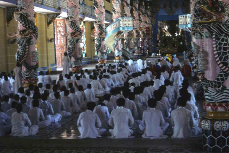 """<img typeof=""""foaf:Image"""" src=""""http://statelibrarync.org/learnnc/sites/default/files/images/vietnam_174.jpg"""" width=""""1024"""" height=""""683"""" alt=""""Followers dressed in white sit worshipping in Cao Dai temple at Tay Ninh"""" title=""""Followers dressed in white sit worshipping in Cao Dai temple at Tay Ninh"""" />"""