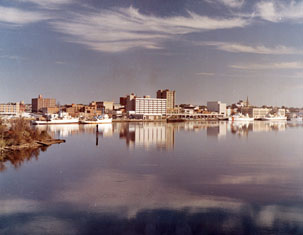 """Wilmington, NC, c.1974, Color Waterfront View of the Business District, view over water."" From Carolina Power and Light (CP&L) Photograph Collection (Ph.C.68), North Carolina State Archives; call #: PhC68_1_77."