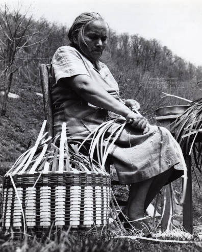 Agnes Welch preparing white oak splits to use in weaving a basket. Image courtesy of Wester Carolina University.