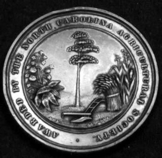 Medal awarded by the North Carolina Agricultural Society for contests at the State Fair, 1853. Image from the North Carolina Museum of History.