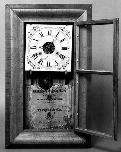 Clock with the label 'Brass clocks made and sold at the Waterbury Factory, North Carolina for Wright & Co.' Circa 1845-1860. Image from the North Carolina Museum of History.