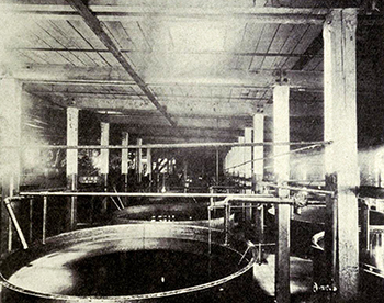 Interior view of a large cotton oil refinery, circa 1911. Image from Archive.org.