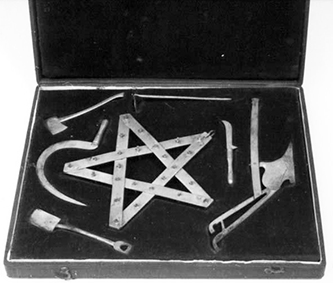 Box of six symbolic miniature tools and a star, used in Grange ceremonies. Image from the North Carolina Museum of History.