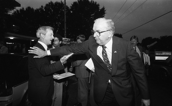 James Hunt and Jesse Helms attending a debate July 29, 1984. Copyright News & Observer, all rights reserved. Used with permission. Housed at the N.C. State Archives, call no. NO_042184_Fr39.