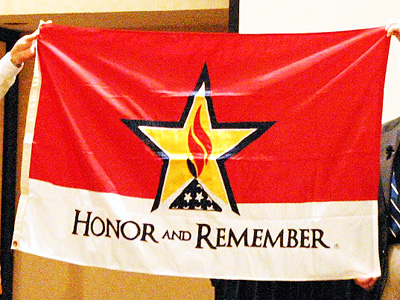 The Honor and Remember Flag at a ceremony at the National Congress of the Sons of the American Revolution in Phoenix, Arizona on July 9, 2012. Image from Picasa user George Lutz.