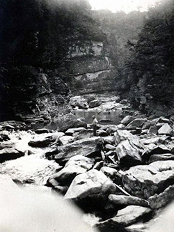 T. B. Wilson fishing in the Linville Gorge, 1919. Image from the North Carolina Museum of History.