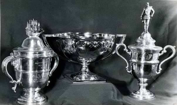 From left to right, the Mayflower Cup awarded by the Society of Mayflower Descendants in the State of North Carolina, the Ruth Coltrane Cannon Cup awarded by Preservation North Carolina, and the Sir Walter Raleigh Award awarded by the Historical Book Club of North Carolina