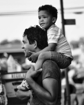 Lumbee father and son watching a homecoming parade