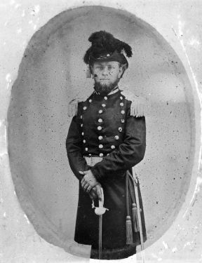 (2nd) Lieutenant Charles B. Cook, Confederate, Fayetteville Independent Light Infantry, early Civil War era, in uniform showing fancy hat and sword. Image courtesy of the State Archives of North Carolina, call #: N_59_12_95.