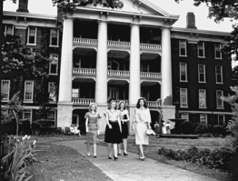 Students take a spring stroll at Peace College, 1947. Courtesy of North Carolina Office of Archives and History, Raleigh.