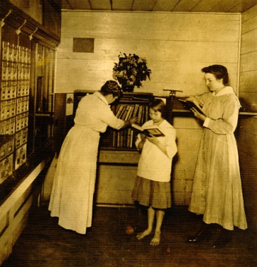 Book deposit station in the Post Office at Jamestown (Guilford County), 1915. In 1915, the county commissioners appropriated funding for free service to county residents living outside the Greensboro city limits. In addition to opening library use to rural residents and offering telephone and mail service, the library placed stations in various places, including post offices, each with a bookshelf holding fifty books. The postmasters often served as librarians.
