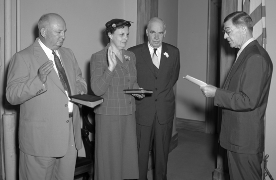 Members of the Rural Electrification Authority being sworn in. From left to right, S.H. Hobbs, Jr. of Chapel Hill, Mrs. Fred Davis of Stoneville, Governor Luther Hodges, and Associate Justice Jeff Johnson Jr., 1955. Image from the State Archives of North Carolina.