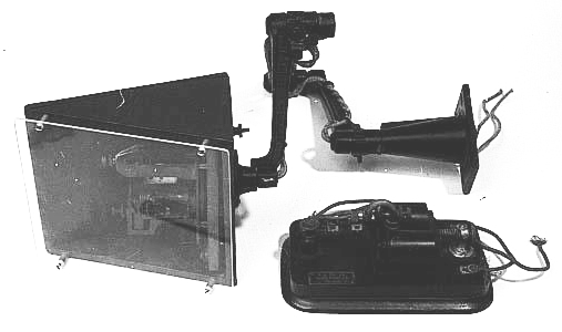 Telegraph transceiver; annunciator and coils on wooden platform with a swivel base fixed to end of a cast iron extension arm, 1918