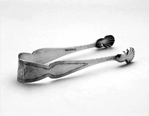 Photograph of sterling silver sugar tongs made by John Volger circa 1810 to 1825.  From the collections of the North Carolina Museum of History.